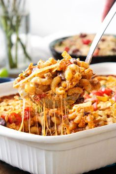 Lighter Cheesy Taco Pasta Bake loaded with juicy beef, beans, pasta etc., smothered in an incredible creamy Enchilada-esque sauce that is out of this world!