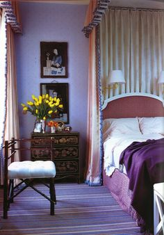 There is something lovely about this room but I can't put my finger on it.  The purple, the fabric, the flowers.  I just love it all.