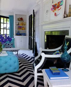 ottoman, colors, and contrast between black & white. liz lange's country residence. design by jonathan adler.