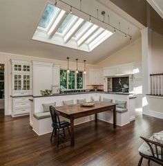The skylights make this kitchen. Booth seating, clean white cabinets, and an open design also help sell me on it.