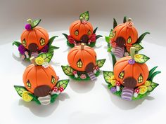 Miniature pumpkin fairy homes in polymer clay.