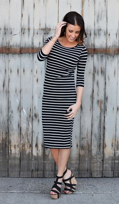 This Striped Midi Dress is easy to dress up or down. It has theperfect combination of style and comfort. You can create a casual look or dress it up with a statement necklace and heels. With 3/4 sleeves and a straight silhouette, this striped dress hits below the knee in a sophisticated midi style.SizingSmall 0-4Medium 4-8Large 8-12Material: 60% polyester 35% polyester 5% Spandex