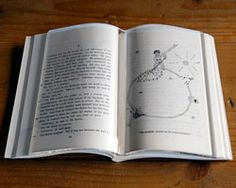 Book on Book: transparent book on book holds your pages flat while you read