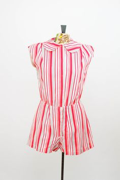 Red, black, grey and white striped romper is from approximately the mid-late 1930s.