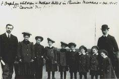 Eight orphan children arrive to Ellis Island from Russia in May 1908 on the SS Caronia.