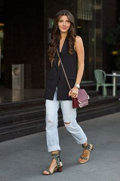 Larisa Costea is wearing a black vest from Sheinside, boyfriend jeans from  Glow, shoes 18f655c6b93