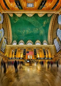 Central View ~ This vertical panorama shows a unique perspective of the main concourse of historic Grand Central Terminal in New York City. This view shows the entire concourse from north to south and east to west including the beautiful depiction of the night sky painted across the ceiling, and the famous brass clock above the information booth. Grand Central Terminal, rebuilt in 1913, is celebrating its 100th anniversary in 2013.