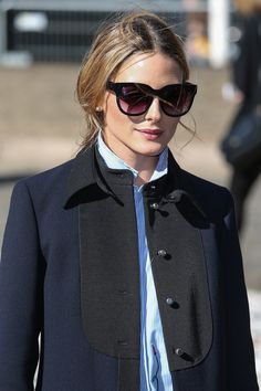 Olivia Palermo turned heads outside Moncler's Spring 2017 show with a romantically undone woven style.