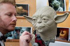 "An artist works on a wax sculpture of Yoda from ""Star Wars. Madame Tussauds, Obi Wan, Wax Museum, Clay Mugs, Star Wars Party, Culture, Film, Sculpting, Cool Art"
