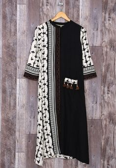 Beautiful cotton Kurti with prints and detailing. Different prints patti create a superb design