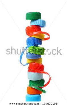 Stack made from bottle caps on white background
