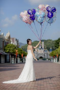 Holding the iconic Mickey Mouse balloons on Main Street, U.S.A in Hong Kong Disneyland