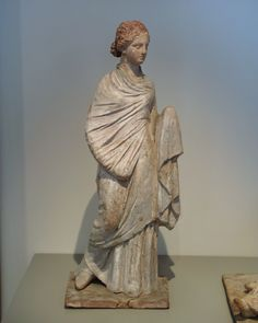 Terrcotta figure from Tanagra,4th century BC.Greece  Museum of fine arts of Lyon