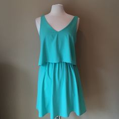Mint Green Dress with Open Back Polyester dress with flounce top and cute open back, elastic waist. No label, fabric tag or size tag. Washes easily. Shown on size 6/8 mannequin and fits well. Estimate size to be medium. Check out the $6 section near the bottom of my closet (before the sold items) for lots of bundle-worthy $6 items! 15% bundle discount on 2+ items in a bundle. Dresses