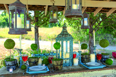 This outdoor dinner is anything but garden variety, thanks to a collection of utterly romantic lanterns. We didn't even have to alter them—they came ready to go in a variety of antique-style patinas. TIP: Cluster these beauties together for rich, can't-look-away appeal. If you're hanging them up, let them hover over your tablescape at different heights.
