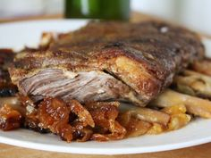 Braised Lamb Ribs with Apricots and Onions | Serious Eats : Recipes.  Also, see Chow recipe, very good.