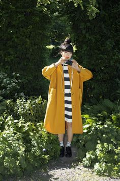 Susie Lau in Monki--love the gold coat