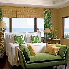 Coastal Living: Soothing Beachy Bedrooms <3 Surf and Turf ~ Woven grass-cloth walls set the tone for a texture-rich hideaway. Driftwood, bamboo, and linen are echoed throughout this bedroom to add depth and dimension to the rain forest color palette.