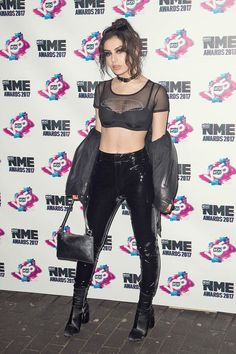 Charli XCX attends NME Awards in patent leather pants