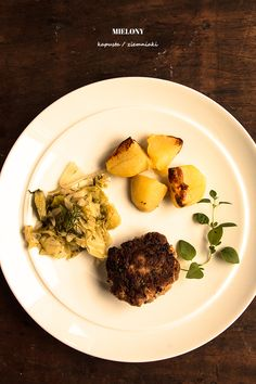 ground beef patty with boiled cabbage and roasted potatoes
