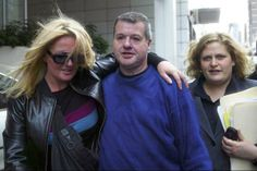 Lewis Moran is greeted by Suzanne Kane outside Melbourne Magistrates Court with legal counsel on the right, July 22 2003. Photo: Craig Abraham