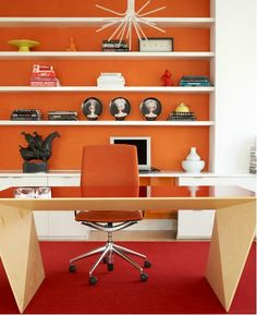 Bringing colours from the runway into the home!  Orange gives an energetic pop of colour to this office.