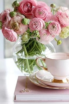 Flower arrangement with pink ranunculus / Flowers and tea