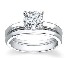 14K White Gold Matching Set   This is a great 14K White Gold Matching Set. This traditional Beautiful Diamond engagement ring is elegant, with its large Shimmering center round cut diamond for all to see and admire. You can choose any center stone for this ring. The wedding band has a high polish finish.  Item# 12422R2  http://www.novori.com/platinum-diamond-wedding-rings-12422R2-p.html