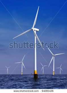 white wind turbine generating electricity on sea by ssuaphotos, via ShutterStock