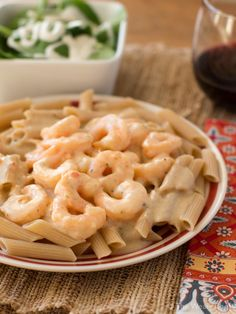 Believe it or not, this delicious Shrimp Scampi Alfredo is ready in about 15 minutes and is lightened up too!