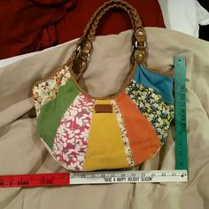Relic handbag, , Medium, tan inside, multiple color on front,  good condition, Relic Bags