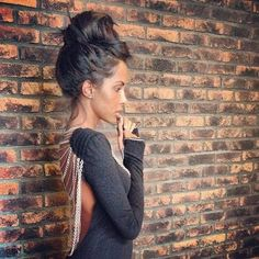 Messy Mohawk bun. I think I love everything about this picture