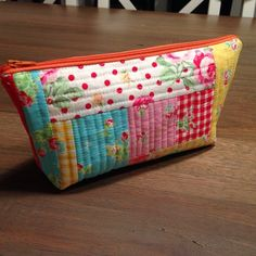 Beautiful quilt as you go pouch.  :)