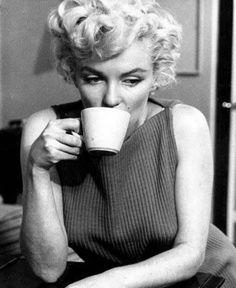 Marilyn Monroe drinking coffee.   I'm very definitely   a woman   and I enjoy it.  Marilyn Monroe