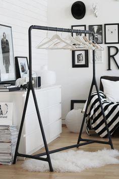 Display Your Favorite Pieces While Taking Advantage Of Additional Closet E Black Rack White Hangers Mirja Kaijanen Dressing Room Ideas
