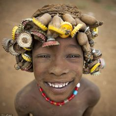 Looking good: Children are also allowed to wear the elaborate headpieces but adult men are not