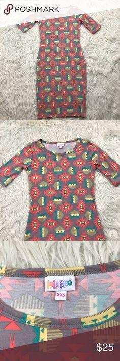 "LulaRoe Julia Dress size xxs - Aztec tribal print LulaRoe Julia Dress  New with tags  Size - Xxs   Approx. measurements laying flat      ⭐️pit to pit - 15"" ⭐️lenght - 36.5"" LuLaRoe Dresses"