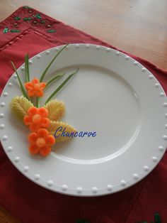 These Two Combinations Of Carrot And Apple Carved Design For Plat Garnish