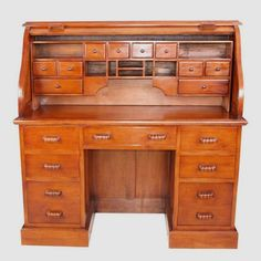 Roll top bureau with filing drawers and desk tidy.