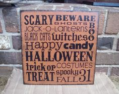 Primitive Halloween Typography Wood Sign Black Cats, Trick or Treat, Boo. $31.99, via Etsy.