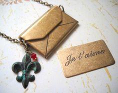 an envelope with sweat words inside & fleur de lis