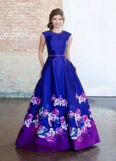 Modest Prom - This printed Mikado ball gown with cap sleeves is pure perfection! The classic jewel neckline and natural waistline are trimmed with matching hand-beading, while the beautiful full skirt features Ellie Wilde's exclusive print and off Modest Formal Dresses, Prom Dresses With Sleeves, Modest Outfits, Homecoming Dresses, Long Dresses, Blush Prom Dress, Formal Gowns, Formal Wear, Maxi Dresses