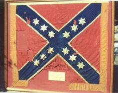 This is the battle flag of the 154th Senior Regiment of Tennessee Volunteers.  It was captured and recaptured at Shiloh.  It is the earliest attempt to standardize the battle flags in the Army of Tennessee.  These flags were ordered by Beauregard in early 1862.  They were made by a sail maker in New Orleans by the name of Cassidy.  It is constructed from light weight cotton fabric with silk stars.  You will note that there are only 12 stars and that they are six-pointed.  The border material…