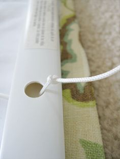 retie the knot on the mini blind for your custom roman shade