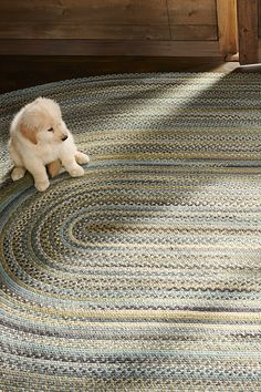 L.L.Bean wool-braided rugs celebrate tradition and craftsmanship – each rug is even handq signed by the artisan who constructed it. Puppy not included.