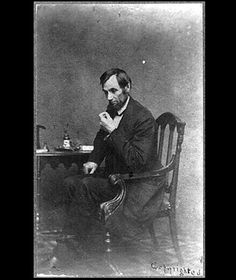 In this portrait by famed Civil War photographer Matthew Brady, Lincoln is shown seated in an armchair.