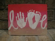 Love sign with kid's hands and feet