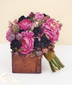 Bouquet of ranunculus, astrantia, and chocolate cosmos- I like the way they're tied and the dark purple in there.