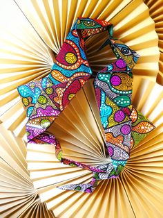 I create the pattern and color the paper myself for all my origami artworks. Here I am working on origami seahorses. Sabbatha Rahzuardi, visual design artist from Bali, Indonesia.