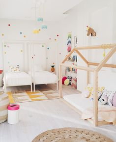 A white-on-white scheme also keeps the look cool in a cheery bedroom for two little girls.